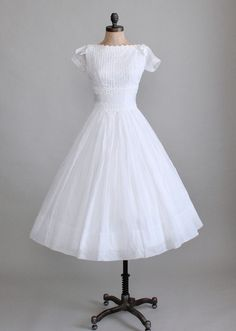 Vintage 1950s White Organdy Wedding Dress from Raleigh Vintage | Snap this one up!  The pleats and bows are stunning!
