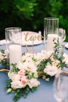 Table two centerpiece: http://www.stylemepretty.com/2014/08/12/intimate-playa-del-carmen-destination-wedding/   Photography: Brandon Kidd - http://www.brandonkidd.net/
