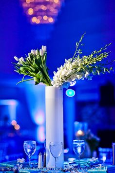 Modern and simply perfect orchid and tulip centerpieces. Boca by Design. Munoz Photography.
