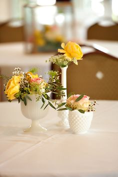 Milk glass-I'm buying/collecting milk glass vases from Goodwill. The arrangements will double as favors.