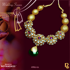 Featuring traditional craftsmanship, this gold necklace is accented with uncut diamonds and highlighted by a green precious stone drop, personifying timeless sophistication.