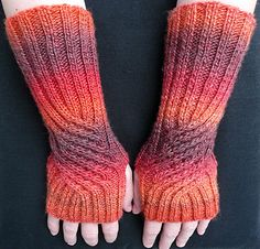 Ravelry: Swirling Gauntlets pattern by Susanna IC. These would be great in handspun!