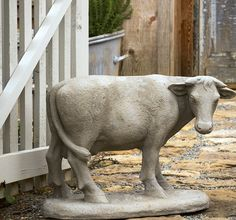 Cast from a favorite antique garden statue, our estate stone milk cow statue will charm everyone she meets. For more garden statues visit Antique Farmhouse.