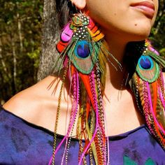 Feathered earrings as a bohemian piece. I find it really interesting.