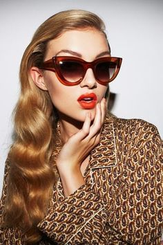 Up the eyewear ante with this season's new shape for sunglasses: the 50s-inspired cat's-eye.