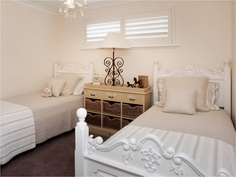 French provincial styled bedroom, ideal for teenagers who are sharing a room- a very feminine yet classic style. Single imported French provincial beds dressed with beige and white quilt sets teamed with a rustic storage cabinet with woven basket and finished with provincial décor.
