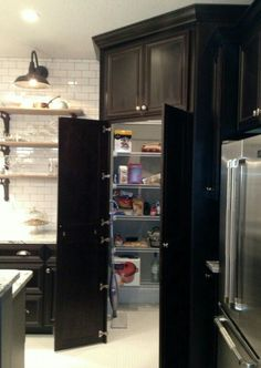 Walk-in Pantry disguised by Cabinetry •Houzz.com•