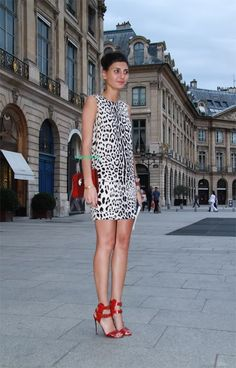 Giovanna Battaglia wearing Dolce & Gabbana animal print dress, a Bulgari red python bag and Manolo Blahnik sandals