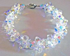 Items similar to Elegant Swarovski Crystal AB or Colourful Bracelet Bridesmaid Bride Gift Present Made to order Any color any size Prom Gift on Etsy Crystal Bracelets, Crystal Jewelry, Cute Jewelry, Jewelry Accessories, Fashion Accessories, Crystals And Gemstones, Swarovski Crystals, Crystal Shop, Bridesmaid Bracelet