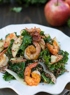 Apple, Quinoa, Kale Salad topped with Spicy Shrimp and Bacon. This salad has fall written all over it.