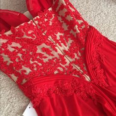 Red Laced Back Prom Dress Red prom dress with laced beading and rhinestones. Only worn once, still in perfect condition. Dresses