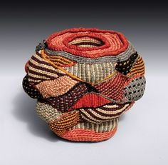 To my mind the first vessel was two hands cupped together and the first basket weave was the intertwining of fingers.  Humans have made baskets for thousands of years.  And they have made them with whatever they: cedar bark in Alaska; bamboo in Japan; discarded telephone wire today in South Africa ... The rich traditions of basket making from around the world provide many possible architectures and countless fiber techniques.   - Lois Russell