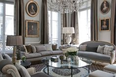 Jean-Louis Deniot. Paris Saint Pres  love the brown and taupe with the silvery blue, and the chandelier above the seating