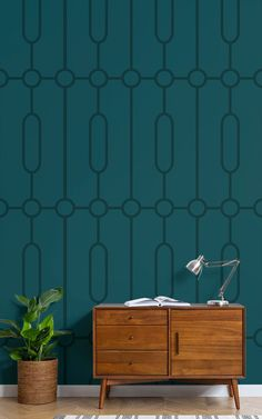 Invite luxurious tone and style into your theme with this Teal Geometric Art Deco Print wallpaper mural, a statement piece that will introduce an interesting new style to your space. Created with iconic art deco characteristics in mind, such as straight and smooth lines and streamlined, sleek forms, this bespoke design will be sure to add a refreshing and modern aesthetic to your space.