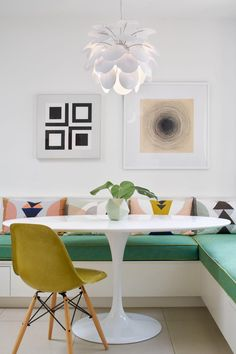 HGTV loves this colorful, modern dining nook with banquette seating and a white tulip table. Banquette Seating In Kitchen, Dining Nook, Dining Room Design, Nook Table, Built In Dining Room Seating, Dining Corner, Banquet Seating, Corner Seating, Booth Seating