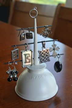 oil can turned jewelry holder = awesome. these would also make the cute christmas trees!