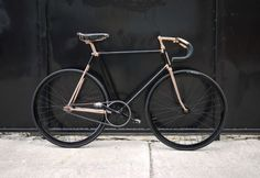 Black fixie bike with gold details