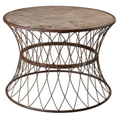 Featuring a metal base and distressed wood top, this handsome coffee table is the perfect addition to your living room or den.   Pro...