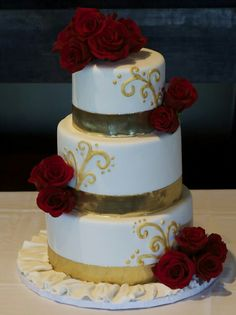 Tri Tier Round White Wedding Cake With Fresh Red Roses And Gold Bands