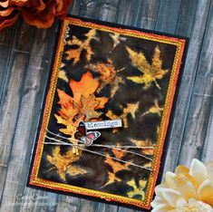 Learn how to create a beautiful background using a layer of inks and a stencil, then watch it come to life when you rub away the top layers of paper.