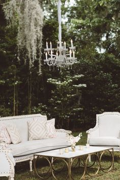 Snyder's Louis Lounge + Ooh Events Gold Ring Coffee Table + Crystal Chandelier | Vintage Southern Wedding at Magnolia Plantation Carriage House by Charleston Wedding Planner ELM Events