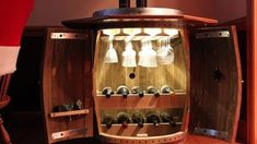 Wine cabinet made from a wine barrel. keep your wine in a wine barrel! Whiskey Barrel Decor, Wine Barrel Bar, Wine Barrels, Woodworking Bench Plans, Woodworking Furniture, Home Furniture, Workbench Plans, Woodworking Classes, Fine Woodworking