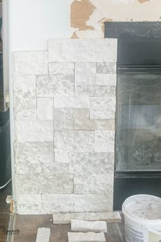 Gorgeous DIY Faux Stone Fireplace Makeover with step-by-step tutorial on how you can make over your own fireplace with this beautiful faux stone.