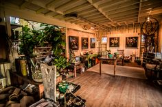 Stunning artistic home converted into a business space featuring reclaimed wood floors, walls and ceiling, rustic and contemporary furniture, cozy decor, indoor plants, outdoor gardens and Venice-inspired bungalow vibe. Perfect for creative events, offsites, meetings or workshops.