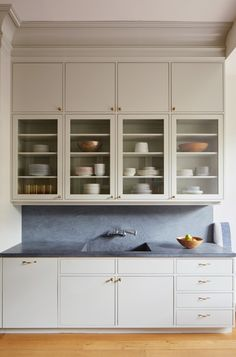 Cabinet drawers and doors are flat face and are inset within a frame. a fresh updated take on the framed style.