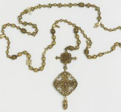German filigree with Murano glass bead rosary.  Around 1800.  Gilded glass beads, glass beads with silver-gilt filigree caps, silver-gilt filigree beads, cast silver-gilt beads Strung on a black cord.