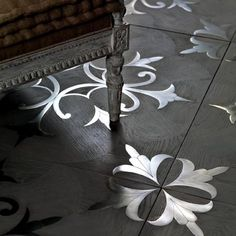 "This ""touch"" is perhaps the distinctive mark of i Vassalletti, and of the Tuscan master artisans. Inlaid flooring in wood and steel, with natural ""pearl gray"" finishing in oil and wax, on our model ""Tuscania"" design. Wood Tile Floors, Solid Wood Flooring, Parquet Flooring, Ceramic Flooring, Wood Parquet, Cement Tiles, Painted Floors, Stone Tiles, Floor Patterns"