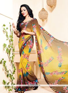 Make the heads flip the moment you dress up in this sort of a attractive multi colour georgette casual saree. Beautified with print work all synchronized well through the design and style and design o...