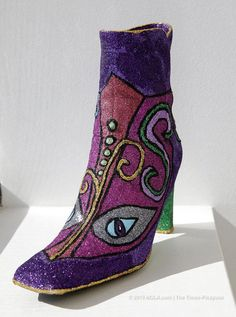 """NOLA. com: """"The Muses shoe remains one of the great throws in Carnival, establishing a personal connection between parade and parade-lover. The krewe has made some creative leaps this year with throws that persist when the parade has past."""""""
