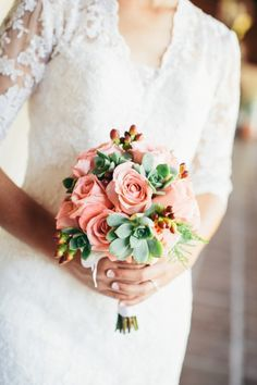 Succulent and rose wedding bouquet gets me every time.