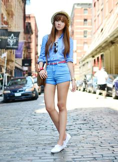 Blue blouse + blue shorts + white Keds sneaker + cross body + sunnies + fedora.