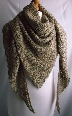 "Brioche rib and garter stitch create a simple, but elegant shawl. Knitted in ""Ruth and Belinda's"" Silky Aran yarn. Spun from Peruvian Alpaca 80% and Mulberry silk 20%. Pure luxury."
