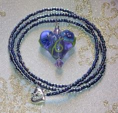 Check out this item in my Etsy shop https://www.etsy.com/listing/215748327/sparkly-purple-flowered-heart-necklace
