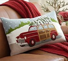 Festive lumbar cover captures that sentiment with a vintage-style station wagon and snowy scene rendered in textural crewel embroidery. | Pottery Barn