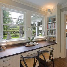 love the desktop space below a window. The side bookshelf is an awesome space saving idea.