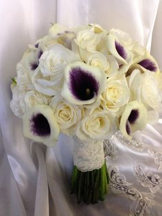 Bridal bouquet  (with 3 added peacock feathers) with green stem wrap and crystal pins