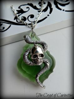 Slytherin house dark mark inspired crystal necklace..
