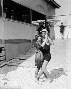 19 Jul 1914, Brooklyn, New York City, New York State, USA --- A couple dressed in bathing suits dances the tango at Brighton Beach