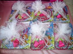 Princess Tea Party Goodybags all wrapped in tulle  (book, necklaces, hair clip & favors)