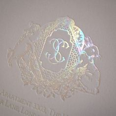 Mother of Pearl monogram crest for a luxury wedding invitation