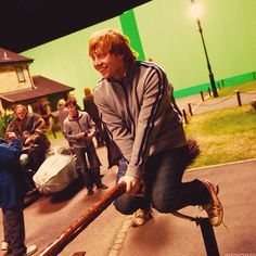 Rupert on a broom, and in the background you can see one of Harry's stand ins and Hagrid's, whose costume is a little too big.