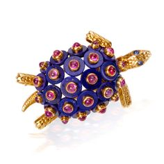 A lapis lazuli, ruby and sapphire turtle brooch, by Cartier, circa 1965