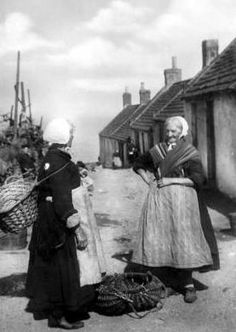 Old photograph image of fishwives outside their cottages n Auchmithie, Angus, Scotland