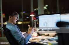 Stock Photo : Businessman with cell phone working late in office