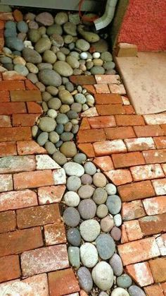 River rock under gutters to help keep water off sidewalks