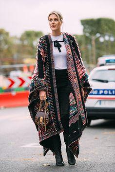 Sofie Valkiers wears Chloe cape, boots and bag, Balmain trousers, Ganni top